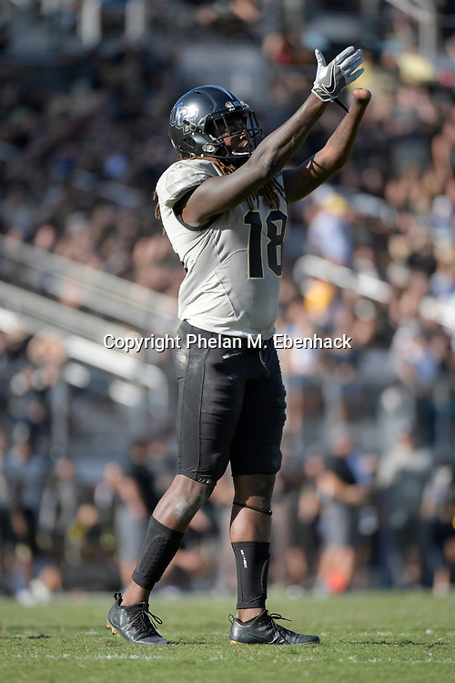 Central Florida linebacker Shaquem Griffin (18) encourages the fans in the stands during the second half of the American Athletic Conference championship NCAA college football game against Memphis Saturday, Dec. 2, 2017, in Orlando, Fla. Central Florida won 62-55. (Photo by Phelan M. Ebenhack)