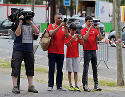 PARIS, FRANCE - Saturday, June 25, 2016: Wales' supporters and Sky Sports' cameraman Alex Gage film the Wales players during a pre-match walk outside the Mövenpick Hotel Paris Neuilly ahead of the Round of 16 UEFA Euro 2016 Championship match against Northern Ireland. (Pic by David Rawcliffe/Propaganda)