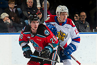 KELOWNA, BC - NOVEMBER 26:  Liam Kindree #26 of the Kelowna Rockets is checked by Riley Sawchuk #13 of the Edmonton Oil Kings after a first period face-off at Prospera Place on November 26, 2019 in Kelowna, Canada. (Photo by Marissa Baecker/Shoot the Breeze)