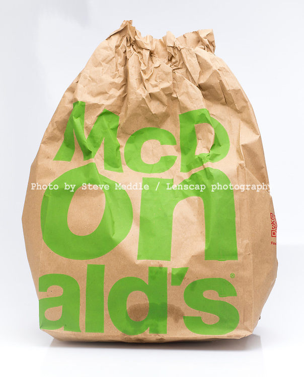 London, England - March 03, 2017: McDonald's Take Away Food in a Brown Paper Bag,  McDonald's is a fast food restaurant chain founded in 1940.