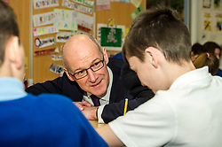 Pictured: John Swinney joined in a primary six art class<br /> Today Deputy First Minister John Swinney visited Niddrie Mill Primary School to announce the publication of Scottish school statistics such as teacher numbers, ratios and class sizes. <br /> <br /> <br /> Ger Harley | EEm 12 December 2017