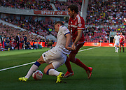 Leeds United FC defender Charlie Taylor clears the ball under pressure fromMiddlesbrough FC midfielder Stewart Downing during the Sky Bet Championship match between Middlesbrough and Leeds United at the Riverside Stadium, Middlesbrough, England on 27 September 2015. Photo by George Ledger.