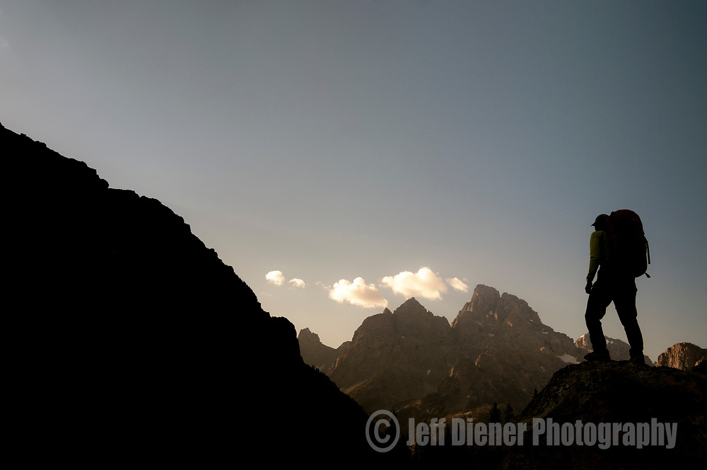 A young man hikes in the north fork of Cascade Canyon in Grand Teton National Park, Jackson Hole, Wyoming.