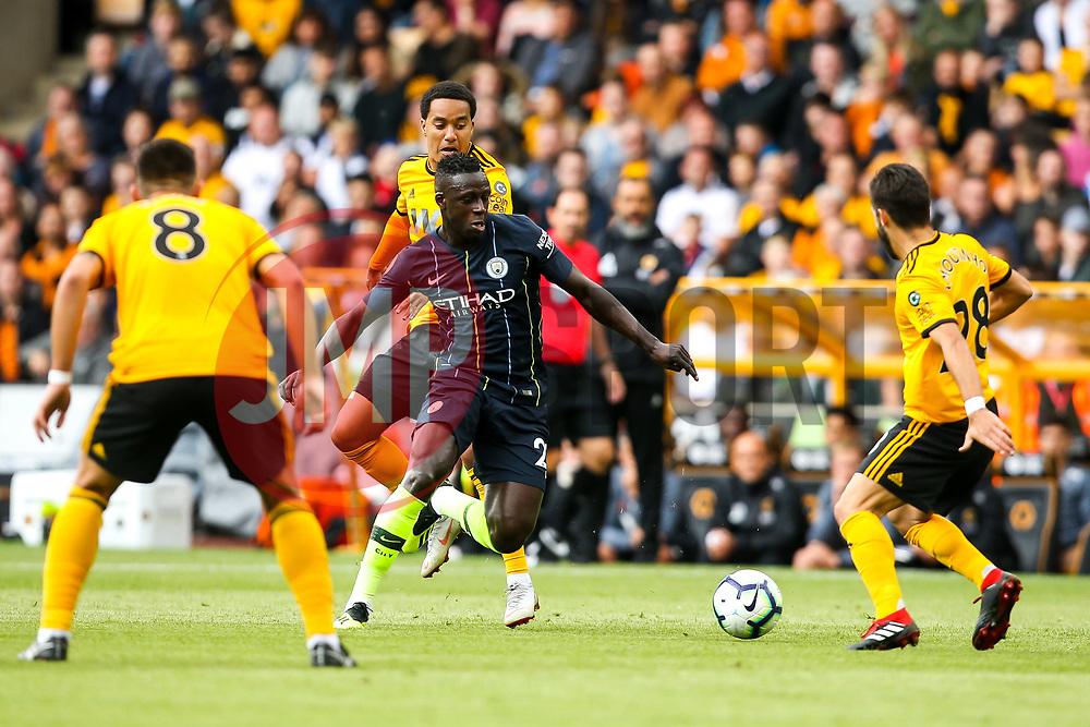 Benjamin Mendy of Manchester City takes on Joao Moutinho of Wolverhampton Wanderers - Mandatory by-line: Robbie Stephenson/JMP - 25/08/2018 - FOOTBALL - Molineux - Wolverhampton, England - Wolverhampton Wanderers v Manchester City - Premier League