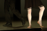 legs of one male and one female dancers
