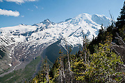 Mount Rainier rises to 14,411 feet elevation. The walk from Sunrise Visitor Center to Burroughs Mountain gives spectacular glacier views in Mount Rainier National Park, Washington, USA. Or for a good workout, hike the Burroughs Mountain 10 mile loop trail which ascends a total of 3200 feet from White River Campground up Glacier Basin Trail, and back via Shadow Lake.