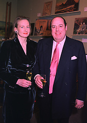 The HON.NICHOLAS & MRS SOAMES he is a good friend of the Prince of Wales, at an exhibition in London on 8th January 1998.MEL 25