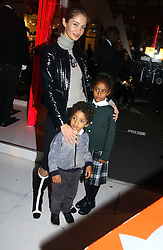 GYUNEL BOATENG wife of designer Oswald Boateng and their children OSCAR and EMILIA at a party to celebrate the launch of DKNY Kids and Halloween in aid of CLIC Sargent and RX Art held at DKNY, 27 Old Bond Street, London on 31st October 2006.<br />