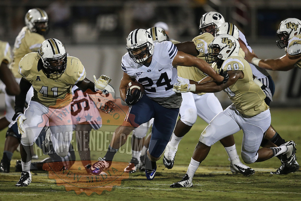 ORLANDO, FL - OCTOBER 09: Algernon Brown #24 of the Brigham Young Cougars runs with the football at Bright House Networks Stadium on October 9, 2014 in Orlando, Florida. (Photo by Alex Menendez/Getty Images) *** Local Caption ***Algernon Brown
