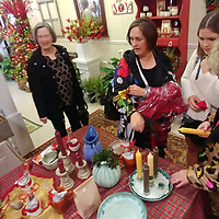 Shoppers browse through pottery at Sam's Plant Station during Aberdeen Main Street Open House Nov. 4.