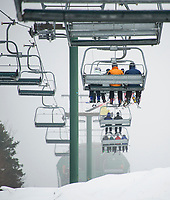 Skiers and riders head to the top on the Panorama lift Tuesday afternoon for some great early season trail conditions with the combination of Gunstock's snow making system and natural snow that fell over the past couple days.  (Karen Bobotas/for the Laconia Daily Sun)