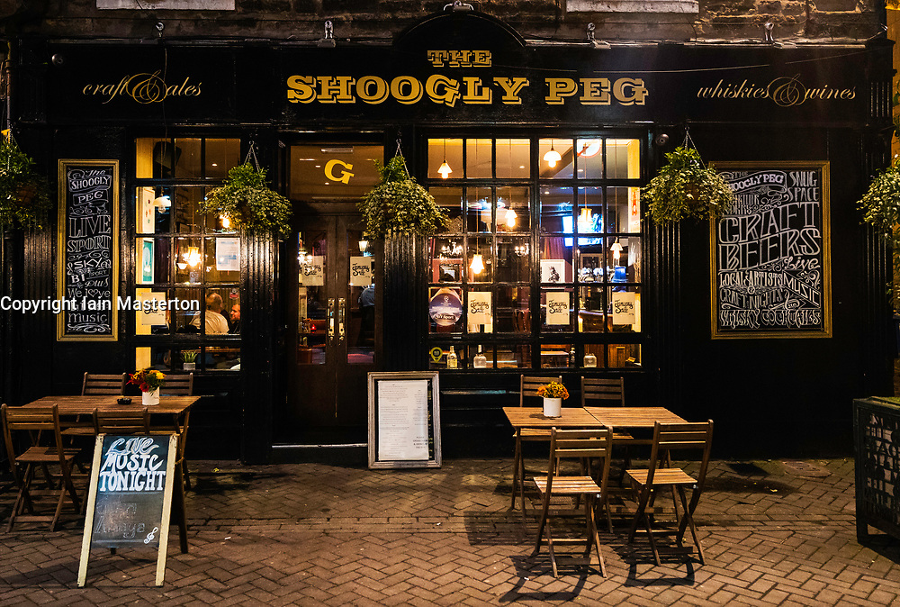 View of The Shoogly Peg pub at night on Rose Street in Edinburgh, Scotland, United Kingdom