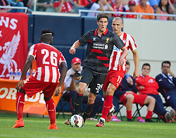 CHICAGO, USA - Sunday, July 27, 2014: Liverpool's Martin Kelly in action against Olympiacos during the International Champions Cup Group B match at the Soldier Field Stadium on day seven of the club's USA Tour. (Pic by David Rawcliffe/Propaganda)