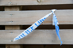 © Licensed to London News Pictures. 30/04/2019. London, UK. Leftover of a police tape tied to the fence in Muswell Hill Broadway, Haringey, north London where a 18 years old man was found suffering from knife wounds shortly after 9.20pm on Monday 29 April 2019. The victim was treated at the scene before being rushed to hospital. Photo credit: Dinendra Haria/LNP