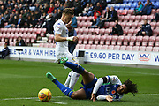 Leeds United midfielder Ezgjan Alioski (10) and Wigan Athletic midfielder Reece James (12) during the EFL Sky Bet Championship match between Wigan Athletic and Leeds United at the DW Stadium, Wigan, England on 4 November 2018.