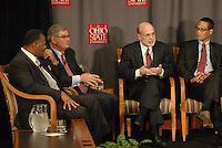 Chairman of the Federal Reserve Board of the United States Ben Bernanke (center) makes his closing remarks at the 'Conversation on the Economy,' a forum held at Pfahl Hall in the Fisher College of Business at Ohio State on Nov. 30, 2010..