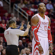 Nov 27, 2013; Houston, TX, USA; Houston Rockets power forward Dwight Howard (12) reacts to getting called for an offensive foul by referee Curtis Blair (74) against the Atlanta Hawks during the first quarter at Toyota Center. Mandatory Credit: Thomas Campbell-USA TODAY Sports