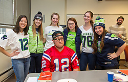George Foster '17, braved wearing a Patriots jersey on Seahawks Blue Friday at PLU on Friday, Jan. 30, 2015. (Photo/John Froschauer)