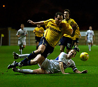 Photo: Richard Lane.<br />Oxford United v Carlisle United. Nationwide Division Three. 13/12/2003.<br />Julian Alsop is tackled by Paul Raven.