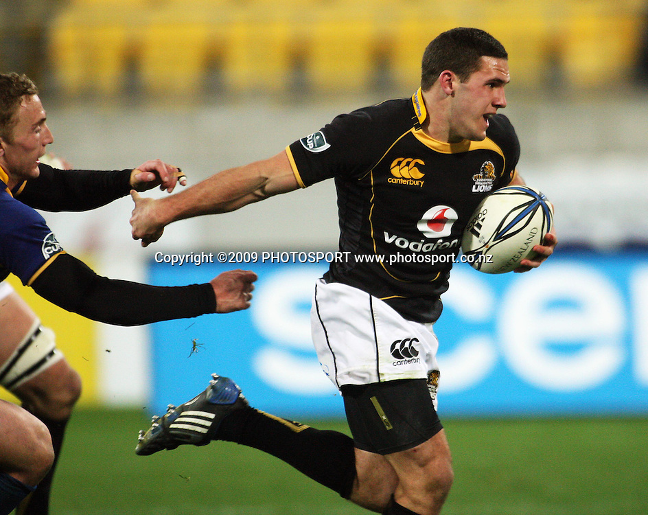 Wellington second five Shaun Treeby breaks to set up Daniel Ramsay's try.<br /> Air NZ Cup Ranfurly Shield match - Wellington Lions v Otago at Westpac Stadium, Wellington, New Zealand. Friday, 31 July 2009. Photo: Dave Lintott/PHOTOSPORT