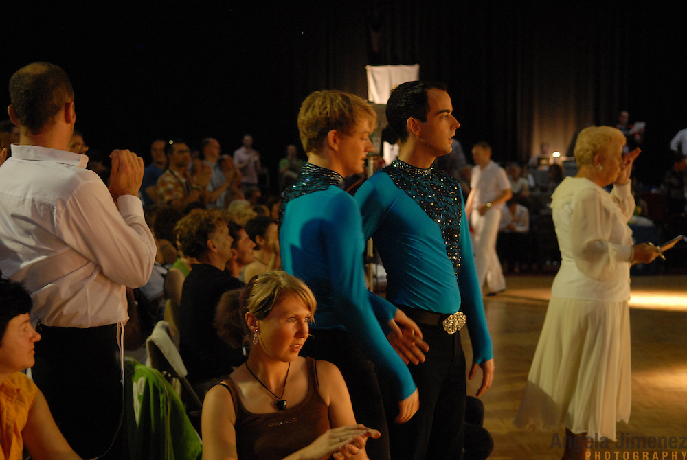 Cor Besseling, center right, and and Arno Doorn, both of Holland, wait to take the floor for the adult men's latin division of the same-sex ballroom dancing competition during the 2007 Eurogames at the Waagnatie hangar in Antwerp, Belgium on July 14, 2007. ..Over 3,000 LGBT athletes competed in 11 sports, including same-sex dance, during the 11th annual European gay sporting event. Same-sex ballroom is a growing sports that has been happening in Europe for over two decades.
