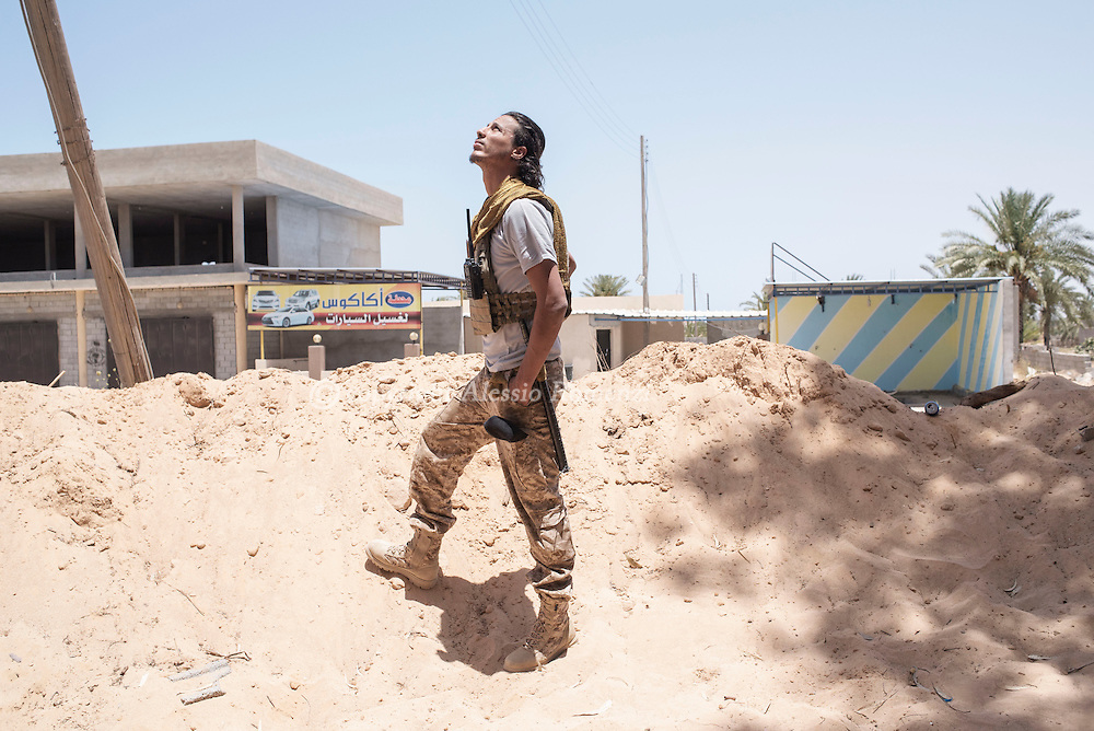 Libya: A Libya's Government of National Accord's (GNA) fighter looks at a Misurata jet fighter as it bombs  ISIS positions in Sirte. Alessio Romenzi