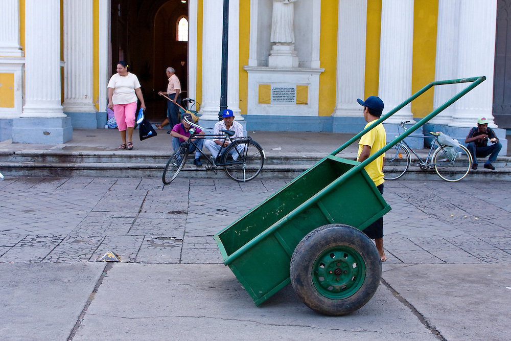 A hand cart outside of the Cathedral of Granada. Granada is Nicaragua's most famous city. founded in 1524 it is one of best examples of Spanish colonial architecture in the Americas. .it has a varied history including its almost total destruction by filibuster William Walker in a childlike tantrum. Today it is a popular tourist town though retains a strong sense of its own identity.