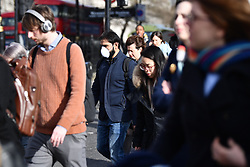 © Licensed to London News Pictures. 09/03/2020. London, UK. A commuter on Westminster Bridge in central London, wearing a medical mask. New cases of the COVID-19 strain of Coronavirus are being reported daily as the government outlines it's plans for controlling the outbreak. Photo credit: Ben Cawthra/LNP