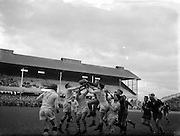 """31/01/1959<br /> 01/31/1959<br /> 31 January 1959<br /> Final Irish Rugby International Trial at Lansdowne Road, Dublin.J.R. Kavanagh, Blues soars highest in this leap for possession following a """"Garryowen""""."""