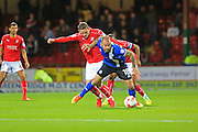 Keith Keane is challenged by Sean Murray during the EFL Sky Bet League 1 match between Swindon Town and Rochdale at the County Ground, Swindon, England on 18 October 2016. Photo by Daniel Youngs.