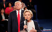 """Republican U.S. presidential nominee Donald Trump listens as Democratic nominee Hillary Clinton answers a question from the audience during their presidential town hall debate at Washington University in St. Louis, Missouri, U.S., October 9, 2016. REUTERS/Rick Wilking /File Photo                  FROM THE FILES PACKAGE """"THE CANDIDATES"""" - SEARCH CANDIDATES FILES FOR ALL 90 IMAGES - RTX2SFHW"""
