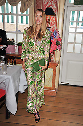 ALEXANDRA MELNICHENKO at a lunch hosted by Roger Viver in honour of Bruno Frisoni their creative director, held at Harry's Bar, 26 South Audley Street, London on 31st March 2011.