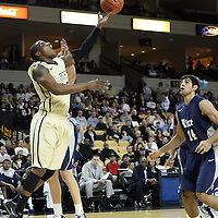 Central Florida forward David Diakite (15) shoots the ball against Arsalan Kazemi (14) of Iran, during a Conference USA NCAA basketball game between the Rice Owls and the Central Florida Knights at the UCF Arena on January 22, 2011 in Orlando, Florida. Rice won the game 57-50 and extended the Knights losing streak to 4 games.  (AP Photo/Alex Menendez)