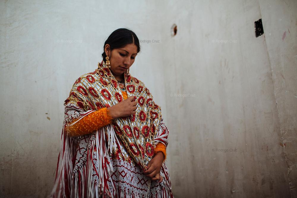 "Patricia Kaly Tito, alias ""Alicia Flores"", gets dressed with the Cholita costume and wrestle at Sunday night in El Alto, beside of La Paz, Bolivia, in El Alto, Bolivia, February 19, 2012."