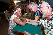 Pirates' Night. Two passengers arm wrestling with (and loosing to) Jimmy from the Sports Team.