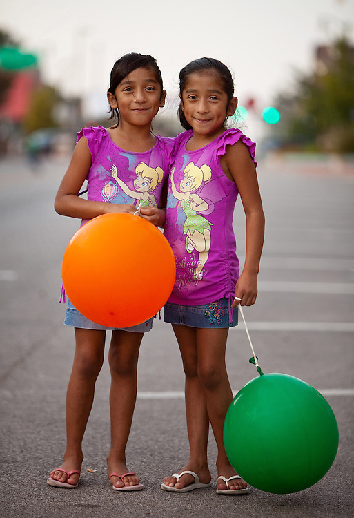 Seven-year-old twins America Perez, left, and Priscilla Perez pose for a portrait during the celebration of Mexican Independence near Plaza Latino on Saturday, Sept. 12, 2009. Omahans gathered on Friday, Saturday and Sunday at the plaza, near 24th and O streets, to celebrate Mexican and other independence days. | Chicago Freelance Photographer | Alyssa Schukar | Photojournalist