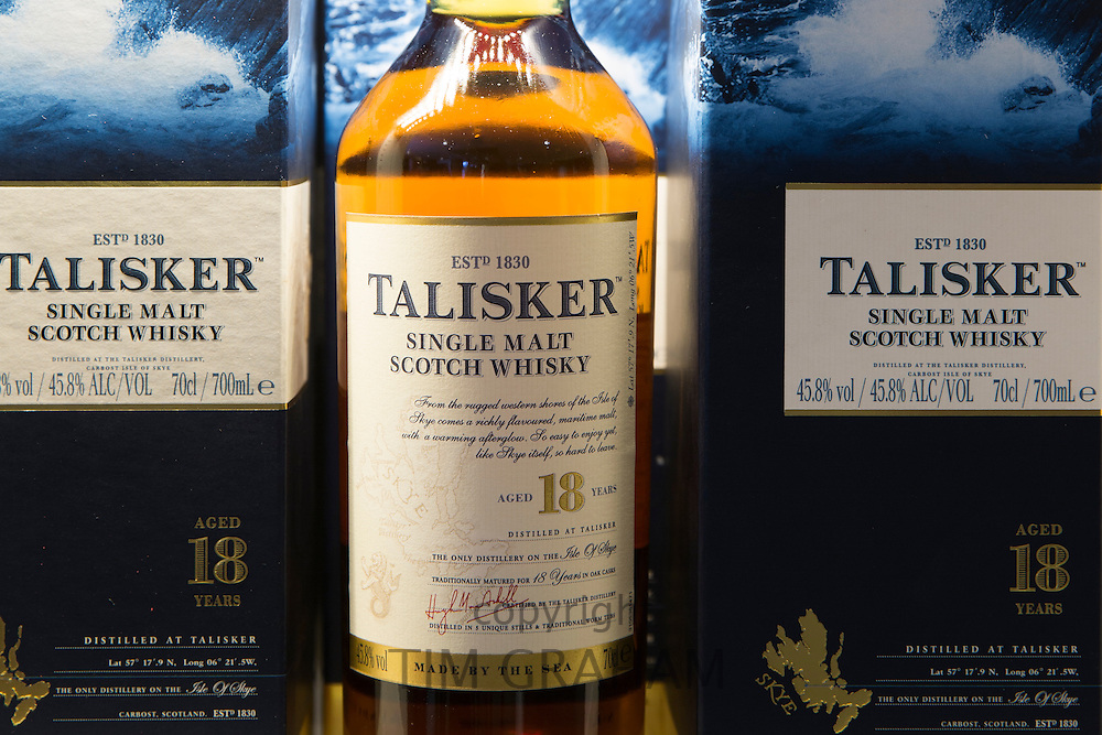 75cl bottles of 18-year-old Talisker single malt Scotch Whisky in cartons on display for sale at shop on visitors tour at Distillery in Carbost, Isle of Skye, Scotland