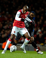 Photo: Ed Godden.<br /> Arsenal v CSKA Moscow. UEFA Champions League, Group G. 01/11/2006. Arsenal's William Gallas (L) keeps the ball from Vagner Love.
