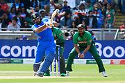 Rohit Sharma of India hits the ball over the boundary for six runs during the ICC Cricket World Cup 2019 match between Bangladesh and India at Edgbaston, Birmingham, United Kingdom on 2 July 2019.