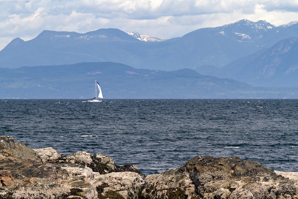 A sailboat in the Straight of Georgia from Rathtrevor Beach Provincial Park in Parksville, British Columbia, Canada