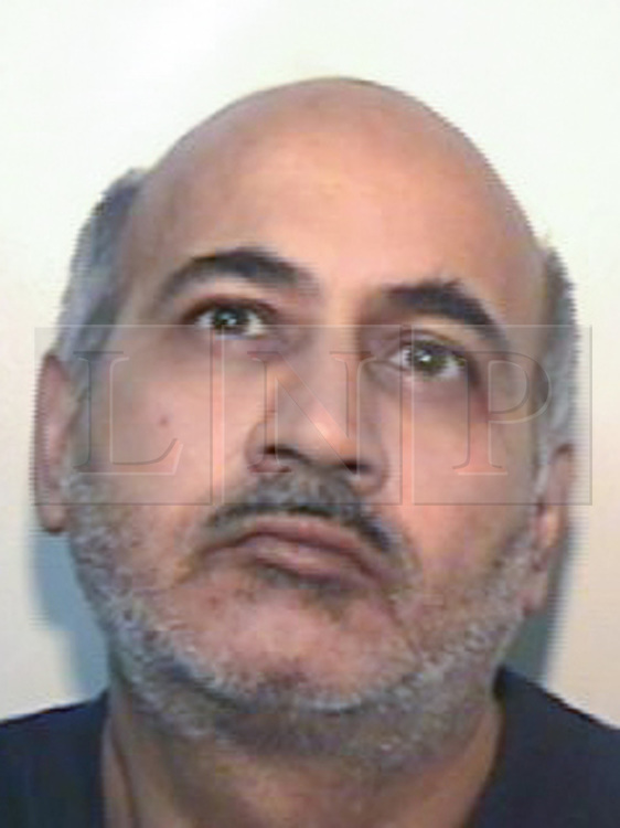 © Licensed to London News Pictures . AFTAB ALAM who has today (30th June 2014) been sentenced to life with a minimum of 12 years for the murder of his wife Aisha Alam on 22nd November 2013 . Aftab and Aisha had been married for 29 years, but a few years ago the marriage began to deteriorate . Aisha reported domestic violence by Aftab in 2011 but did not want police to prosecute . Shortly after this , Aftab left the family home . Aftab subsequently returned to the family home , but the relationship was tempestuous . On the morning of Friday 22 November 2013 Aftab Alam drove to Longsight Police Station and told police he had killed his wife . Police attended the family home and found Aisha , a mother of four , lifeless on the couch in her home . Aftab Alam had launched an unprovoked attack , stabbing her multiple times in the chest , neck and back , killing her . Photo credit : Joel Goodman/LNP