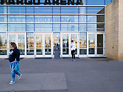 """13 MARCH 2020 - DES MOINES, IOWA: People walk away from the entrance to Wells Fargo Arena after not being able to get in. The arena is hosting the state boys high school basketball tournament. Tournament organizers announced that no spectators would be allowed at games starting Friday. The Governor of Iowa announced Friday that 17 people in Iowa have tested positive for the Novel Coronavirus. Of those, 15 people were exposed on the same cruise in Egypt, the others were exposed through travel but were not on the same cruise. The Governor said there has not yet been any """"community spread"""" in Iowa. All of the Iowans who have tested positive are in self quarantine. Across Iowa, municipalities and businesses are taking steps to implement """"social distancing."""" Most of the colleges in Iowa have announced that they will remain closed after their spring breaks and that classes will move to online only, after spring break. Many businesses in Des Moines, including Nationwide Insurance and EMC Insurance, have announced plans to have their employees to telecommute. The mayor of Des Moines has urged event planners to consider canceling large events.     PHOTO BY JACK KURTZ"""