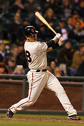 May 24, 2011; San Francisco, CA, USA;  San Francisco Giants catcher Buster Posey (28) hits a single against the Florida Marlins during the ninth inning at AT&T Park. Florida defeated San Francisco 5-1.