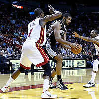 17 January 2012: San Antonio Spurs center Tim Duncan (21) drives past Miami Heat power forward Chris Bosh (1) and Miami Heat small forward James Jones (22) during the Miami Heat 120-98 victory over the San Antonio Spurs at the AmericanAirlines Arena, Miami, Florida, USA.