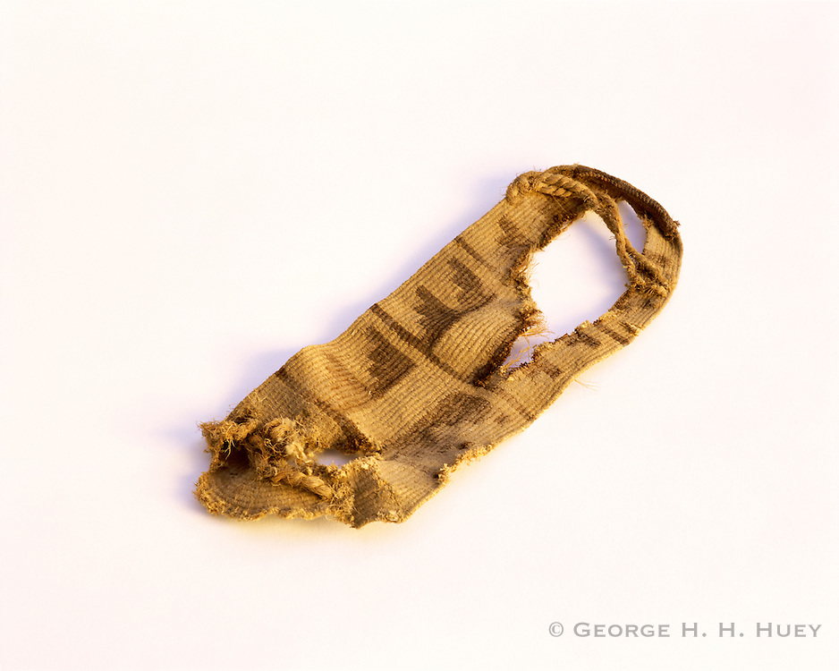 0201-1018B ~ Copyright: George H. H. Huey ~ Anasazi culture yucca fiber decorated sandal. ca. A.D. 1100's. Found at Aztec Ruins National Monument, New Mexico.