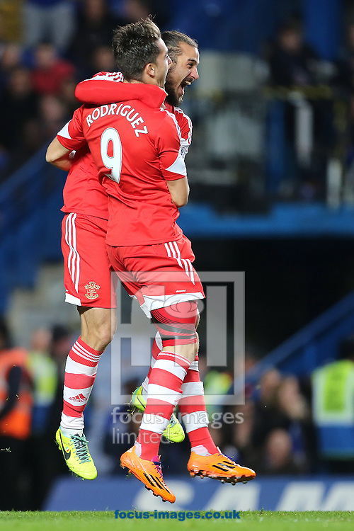 Picture by Richard Calver/Focus Images Ltd +447792 981244<br /> 01/12/2013<br /> Jay Rodriguez of Southampton is congratulated by team mate Pablo Daniel Osvaldo after scouring the opening goal during the Barclays Premier League match against Chelsea at Stamford Bridge, London.