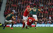 South Africa's Damian De Allende  getting tackled by Wales Jamie Roberts during the Rugby World Cup Quarter Final match between South Africa and Wales at Twickenham, Richmond, United Kingdom on 17 October 2015. Photo by Matthew Redman.