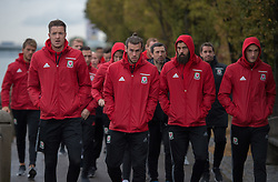 VIENNA, AUSTRIA - Thursday, October 6, 2016: Wales' Gareth Bale with Joe Ledley Wayne Hennessey and Andy King lead the Wales team during a pre-match walk at the Hilton Danube Waterfront Hotel ahead of the 2018 FIFA World Cup Qualifying Group D match against Austria. (Pic by Peter Powell/Propaganda)