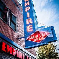 """Picture of Empire Tavern and Liquors neon sign in Fargo, North Dakota.  The rustc old bar sign also says """"Grain Belt Beer""""."""