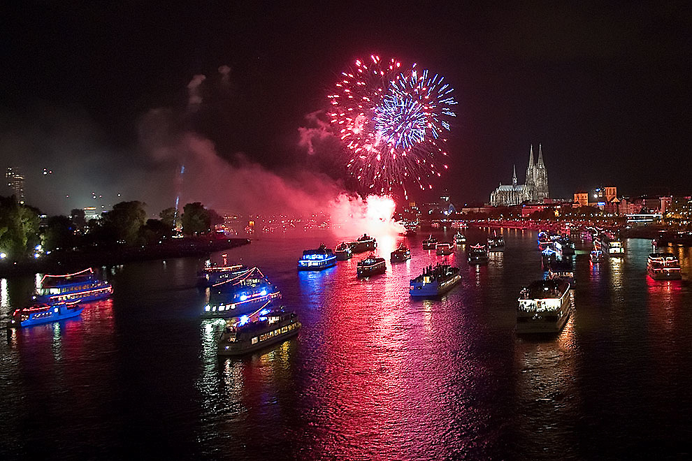 Germany - Köln- Koeln - Cologne river Rhine (Rhein)  and boats during the event of Kölner Lichter 2010 with the Dom the Cologne  Cathedral in the background